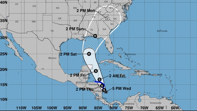 A graphic issued by the National Hurricane Center at 5 p.m Wednesday shows the position and possible track of Tropical Depression Sixteen.