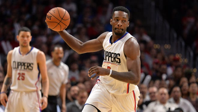 Jeff Green dribbles the ball against the Denver Nuggets during the second half at Staples Center.