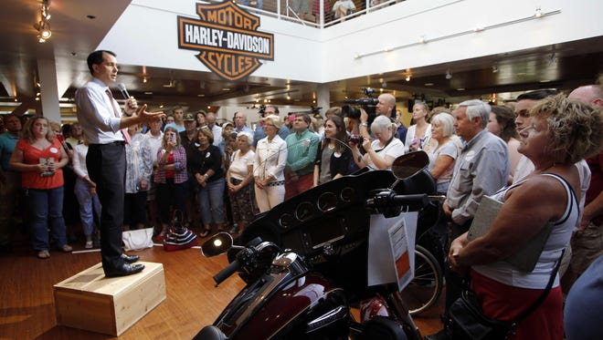 Republican presidential candidate Wisconsin Gov. Scott Walker speaks to a crowd Thursday at Seacoast Harley Davidson during a campaign stop in North Hampton, N.H.