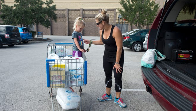 Ainsley Meeker, 2, of Stuart, was emotional after shopping with her mother, Stephanie, in preparation for Hurricane Matthew on Oct. 4, 2016 at Walmart in Stuart.