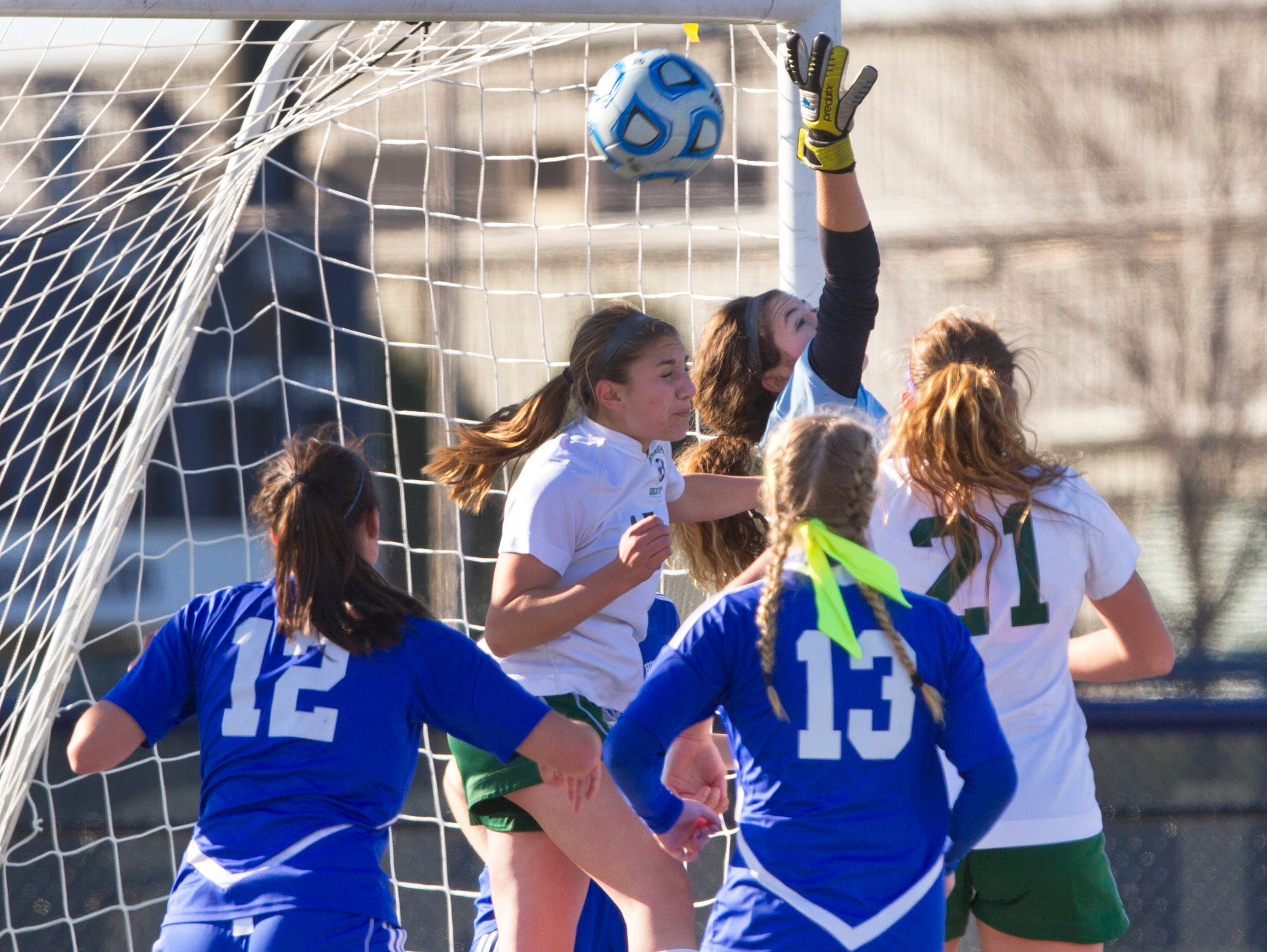 Holmdel goalie Mattie Milkowski reaches back can't stop a shot on goal that was eventually kicked in for Ramapo's second goal in their 2-0 win over Holmdel. Holmdel Girls Soccer vs Ramapo in NJSIAA State Group II Championship at Kean University on November 21, 2015 in Union, NJ.