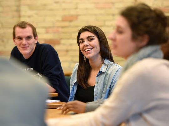 CSB student Anna Cron smiles while talking with other
