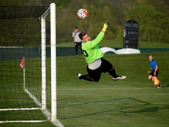 Detroit City FC goalkeeper Evan Louro makes a save during the U.S. Open Cup game against Michigan Bucks on Wednesday, May 11, 2016, at Oakland University in Auburn Hills, MI.