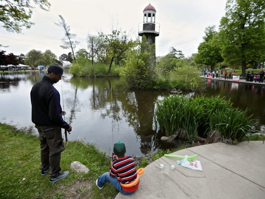 Bernard Gleton, 32, and his nephew Zachary Marshall, 6, during the 20th annual Detroit Fishing Derby on Saturday.
