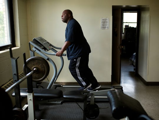 Kwesi Aidoo, 40, of Detroit, works out at the gym inside