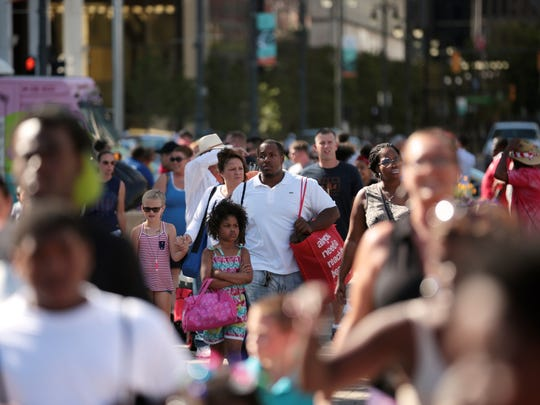 People make their way to the Ford Fireworks festival at Hart Plaza in downtown Detroit on Monday, June 27, 2016.