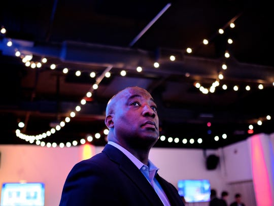 Michael Ford, CEO of RTA, watches the election on TV