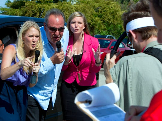 Billy Fuccillo, center, is pictured with sidekicks Abby Sommers and Caroline Renfro, right, during a photo shoot in April 2012 for Fuccillo Kia commercials.
