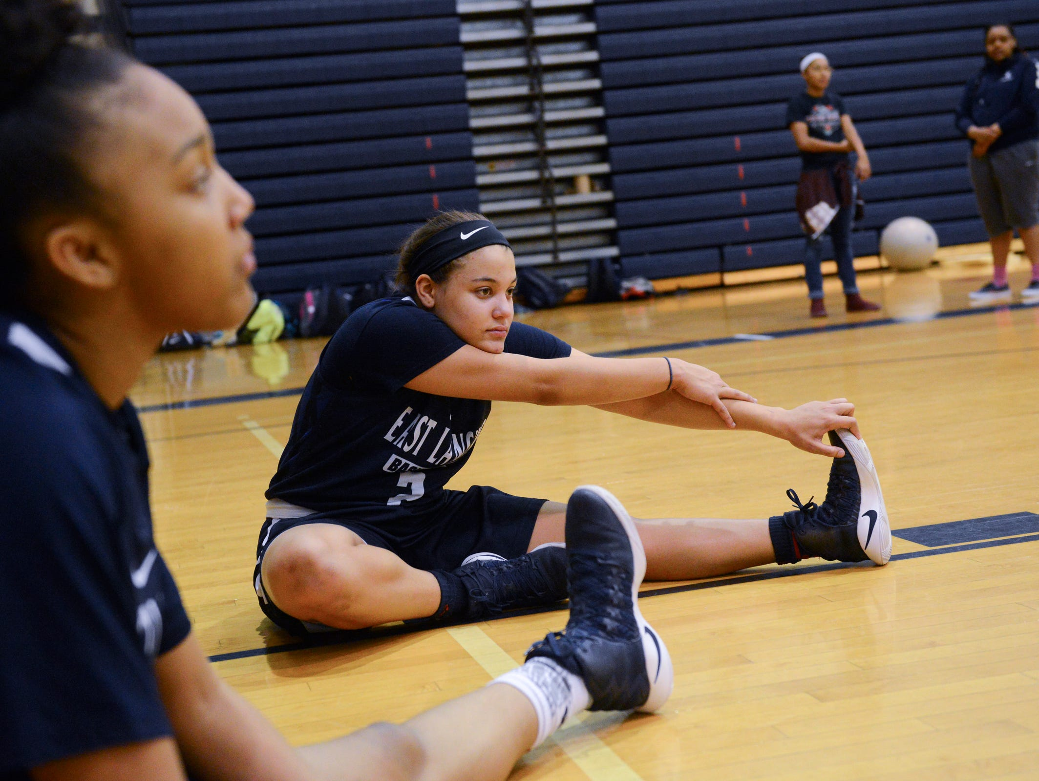 Amelia McNutt stretches on Thursday, Feb. 23, 2017 at East Lansing High School.