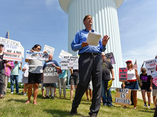 Jim Reed spoke during a protest Wednesday, July 5, as residents demand a response from U.S. Rep. Tom Emmer held near the Municipal Athletic Complex.