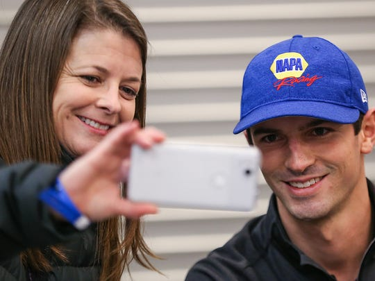 Brenda Butz takes a selfie with IndyCar driver Alexander Rossi during the 100 Day Countdown Party for the 102nd Indianapolis 500 presented by PennGrade Motor Oil, at Indianapolis Motor Speedway, Friday, Feb. 16, 2018.