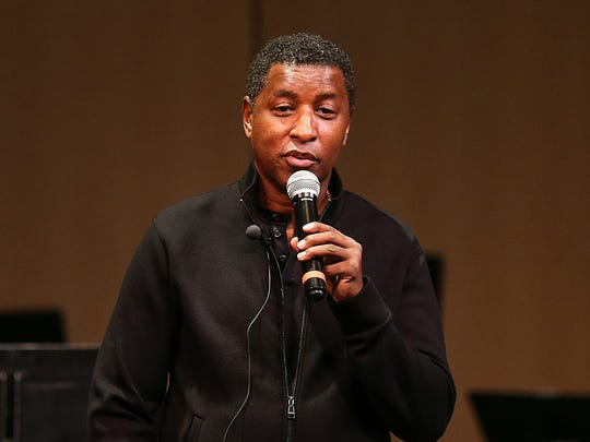 "Kenny ""Babyface"" Edmonds speaks to students while visiting his alma mater, North Central High School in Indianapolis, Tuesday, April 24, 2018."