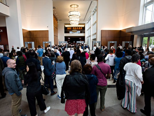 People wait in the security line at EJI's Symposium at Renaissance Hotel on Thursday, April 26, 2018, in Montgomery, Ala.
