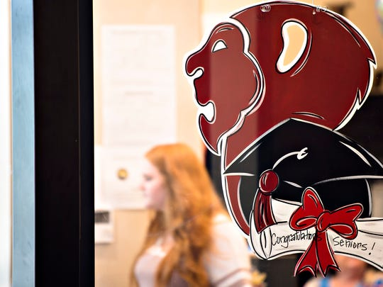 A student worker works in the Prattville front office on Wednesday, April 25, 2018, in Prattville, Ala.