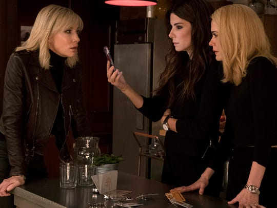 Lou (Cate Blanchett, left), Debbie (Sandra Bullock) and Tammy (Sarah Paulson) join forces to steal a diamond necklace from the neck of a famous actress (Anne Hathaway).