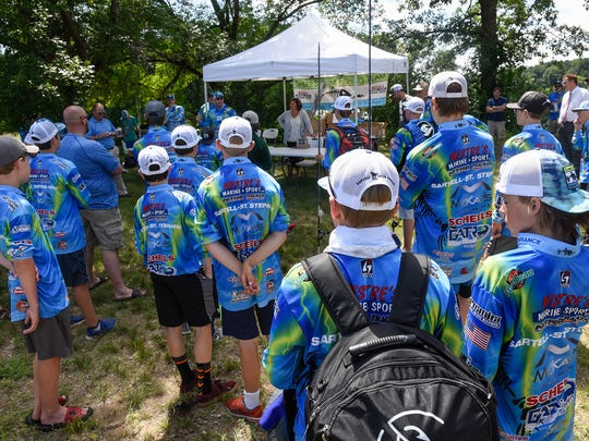 SabreStorm Fishing Team members gather to listen to coaches and speakers during an event Wednesday, June 27, near the Mississippi River.