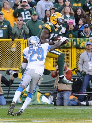 Crezdon Butler breaks up the pass from Aaron Rodgers to Davante Adams on the 2-point conversion try, preserving the Lions' 18-16 lead in the fourth quarter.