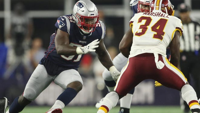 Patriots linebacker Ja'Whaun Bentley moves in to tackle Byron Marshall during a preseason game.