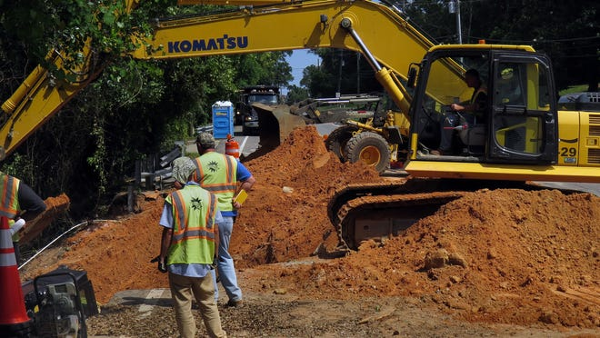 Repairs continue to this flood damaged section of Scenic Highway near the intersection with Baywalk Circle Friday afternoon.