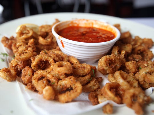 Fried Calamari is an appetizer served at Cafe Portofino