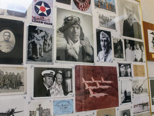 Old photographs from veterans are displayed all over