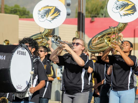 The Alamogordo High School marching band marched down