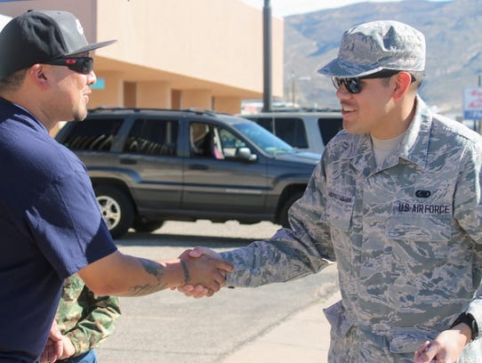 A resident shakes hands with a Holloman Air Force Base