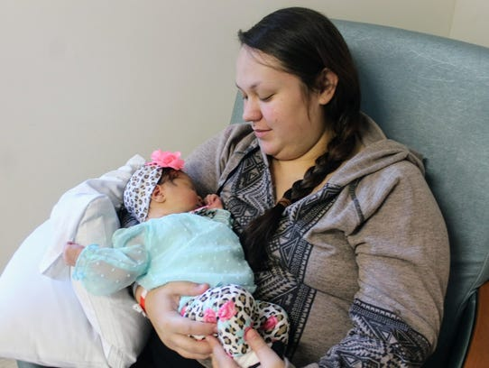 Courtney Clack holds her baby Dalilah in her hospital