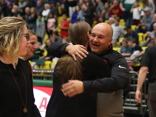 Hurricane coaches embrace following the Tigers' semifinal