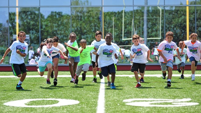 NFL PLAY 60 Character Camp, held Friday at the New York Jets Training Facility in Florham Park, offers youth the opportunity to experience the game of football, while working on fitness, team building and character.