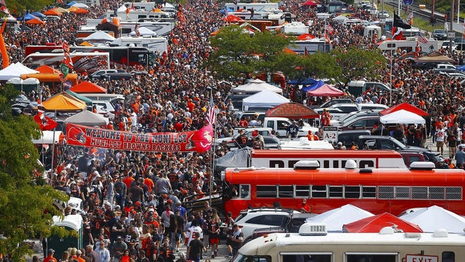 Browns fans crowd the North Coast Municipal Parking Lot before an NFL game between the Cleveland Browns and Tennessee Titans, Sunday, Sept. 8, 2019, in Cleveland, Ohio.
