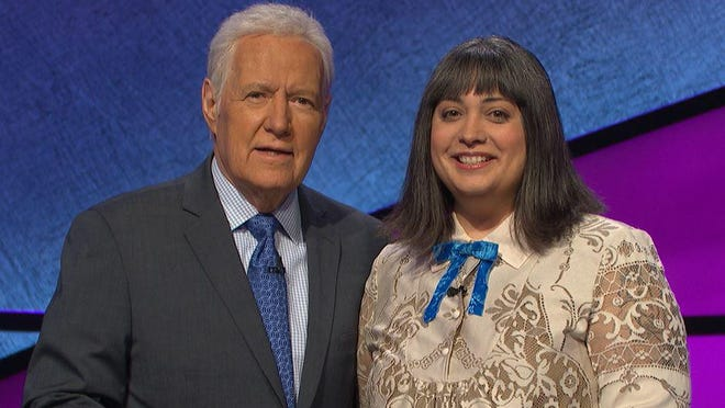 Lake Worth resident and Palm Beach State College professor  Adella Irizarry is shown with Jeopardy! host Alex Trebek during her appearance on the show in Novemeber.