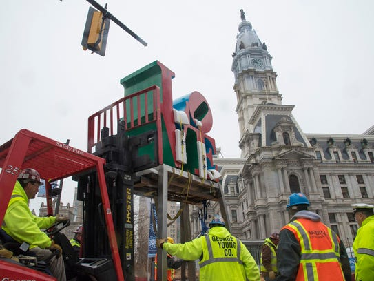 Workers in 2016 temporarily relocate the LOVE Park