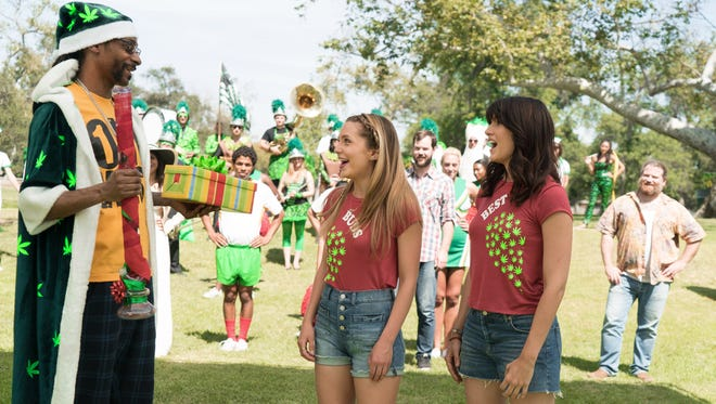 Snoop Dogg guest stars in MTV's 'Mary + Jane,' as a character whom Paige (Jessica Rothe, left) and Jordan (Scout Durwood) meet in the Season 1 finale.