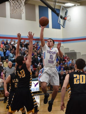 Southern Door's Nick LeCaptain drives the lane against Algoma last season. LeCaptain is averaging 22.0 points per game to lead the Eagles this year.