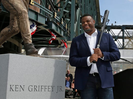 Seattle Mariners Hall of Famer Ken Griffey Jr. poses for a photo with a statue of him that was unveiled Thursday, April 13, 2017, in front of Safeco Field in Seattle. (AP Photo/Ted S. Warren) ORG XMIT: WATW302