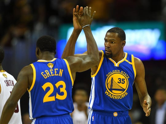 Jun 7, 2017; Cleveland, OH, USA; Golden State Warriors forward Kevin Durant (35) and forward Draymond Green (23) celebrate during the first quarter against the Cleveland Cavaliers in game three of the 2017 NBA Finals at Quicken Loans Arena. Mandatory Credit: Ken Blaze-USA TODAY Sports ORG XMIT: USATSI-359435 ORIG FILE ID:  20170607_pjc_bk4_019.JPG