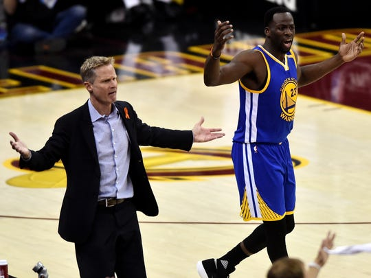 Jun 9, 2017; Cleveland, OH, USA; Golden State Warriors forward Draymond Green (23) and head coach Steve Kerr react during the first quarter against the Cleveland Cavaliers in game four of the Finals for the 2017 NBA Playoffs at Quicken Loans Arena. Mandatory Credit: Ken Blaze-USA TODAY Sports ORG XMIT: USATSI-359436 ORIG FILE ID:  20170609_pjc_bk4_070.JPG