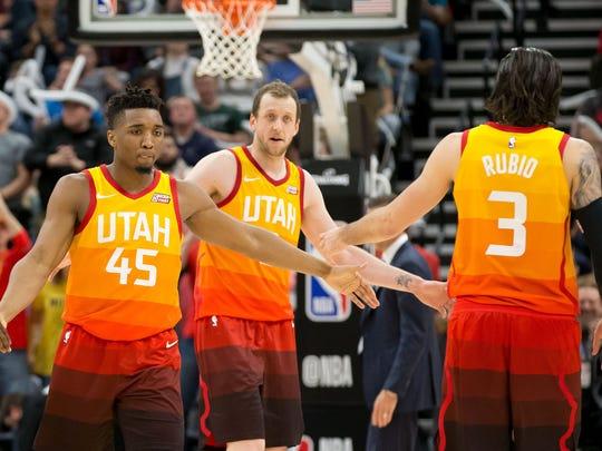 Utah Jazz guard Donovan Mitchell (45) and forward Jae