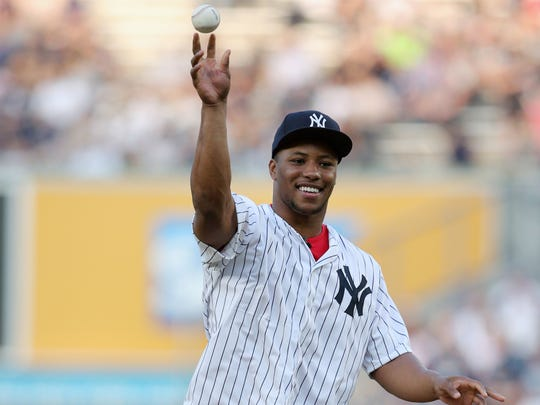New York Giants rookie running back Saquon Barkley throws out the first pitch before a game between the New York Yankees and the Houston Astros at Yankee Stadium.