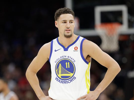 Golden State Warriors' Klay Thompson watches in the