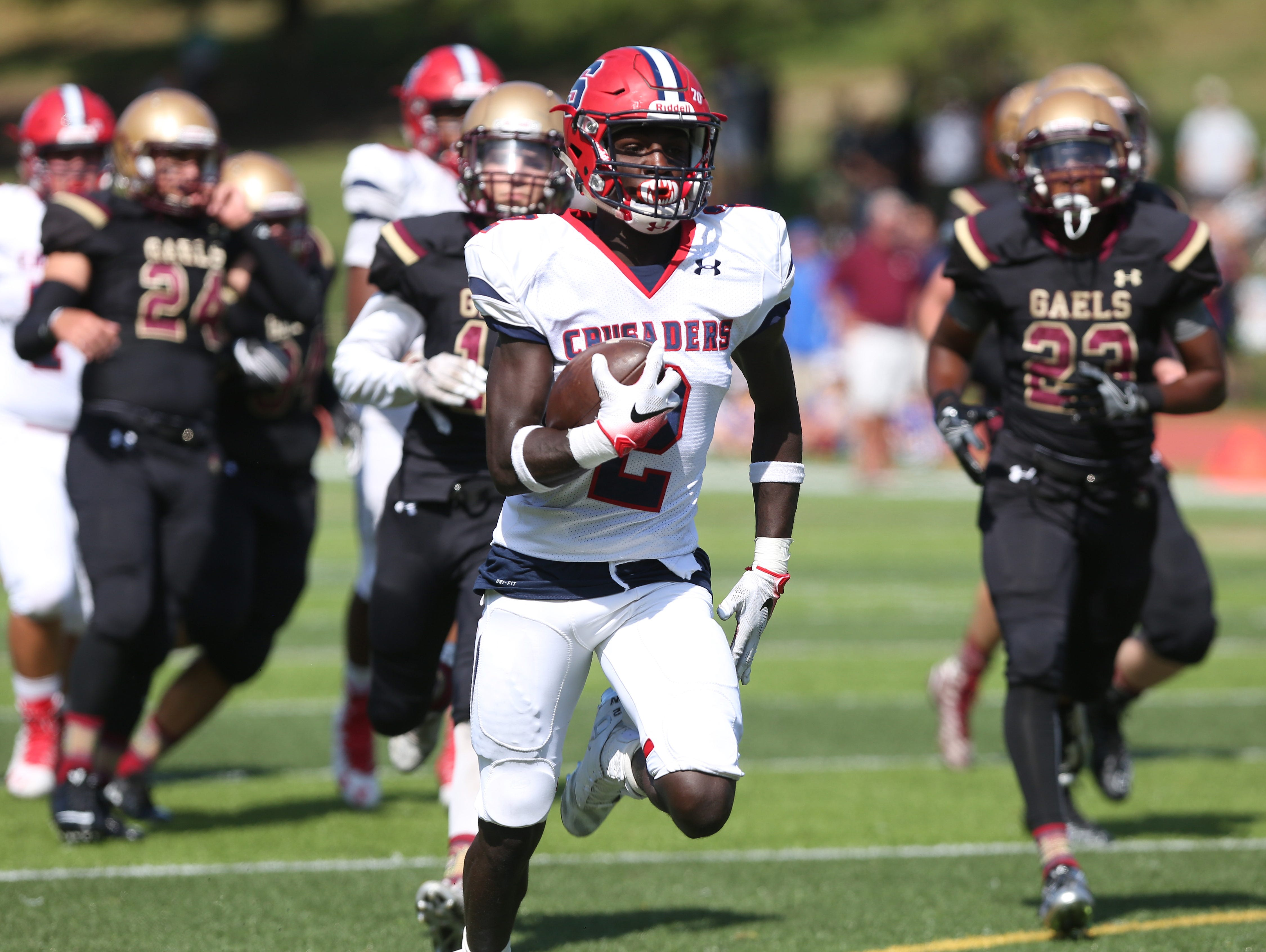 Stepinac's Atrilleon Williams (2) is chased by Iona defenders as he runs into the end zone in the second quarter for his second touchdown of the game, during football action at Iona Prep in New Rochelle Sept. 17, 2016. Stepinac won the game 42-34.
