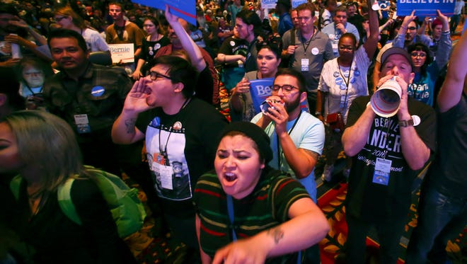 In a May 14,  photo, supporters of Democratic presidential candidate Bernie Sanders react as U.S. Sen. Barbara Boxer, D-Calif., speaks during the Nevada State Democratic Party's 2016 State Convention at the Paris hotel-casino in Las Vegas. The Nevada Democratic Convention turned into an unruly and unpredictable event, after tension with organizers led to some Bernie Sanders supporters throwing chairs and to security clearing the room, organizers said.