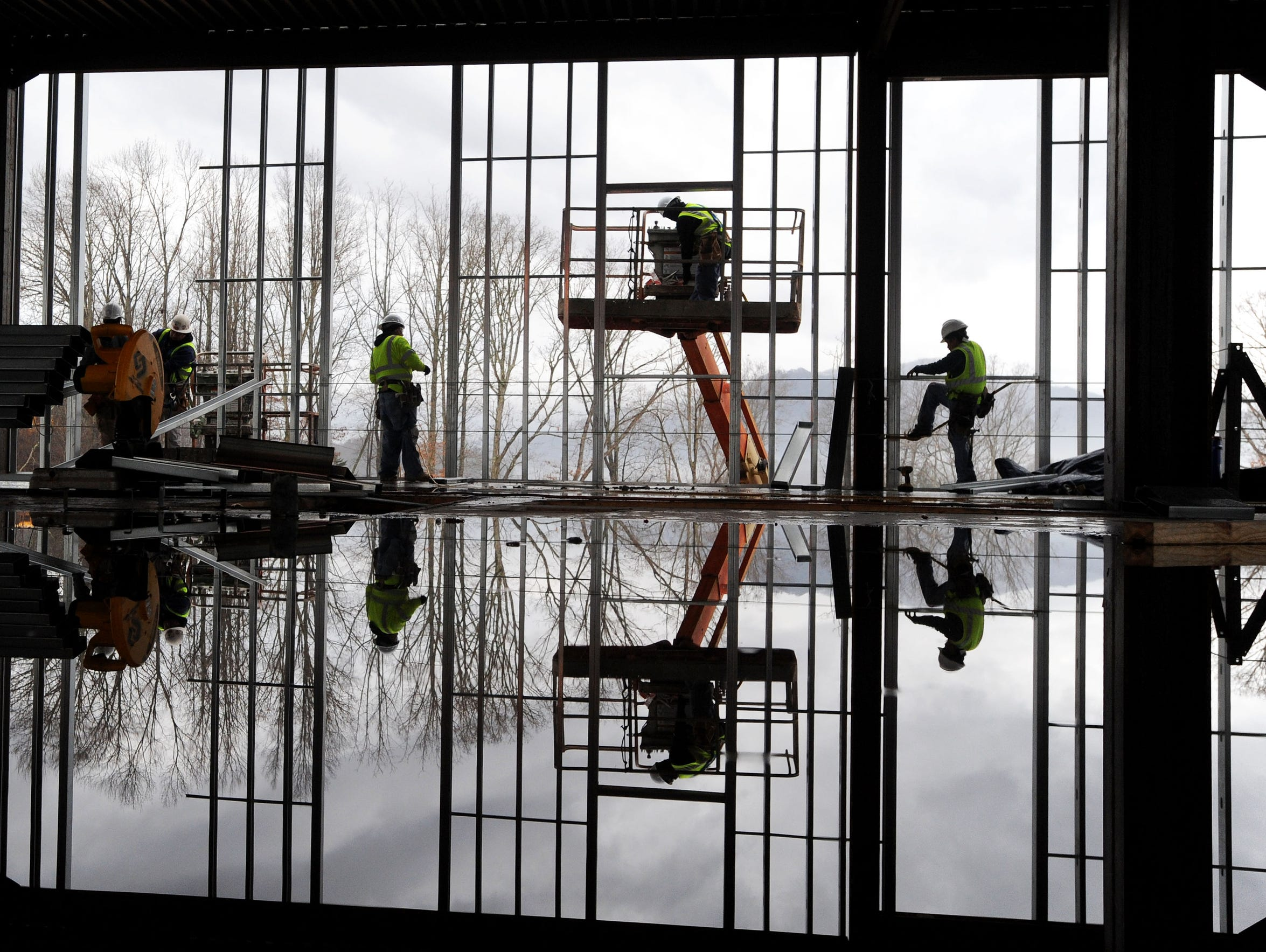 Workers with Vannoy Construction continue the metal