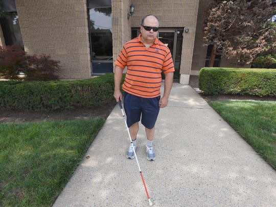 Barry Honig is visually impaired and needs his seeing