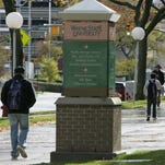 Students walk on the campus of Wayne State University in Detroit.