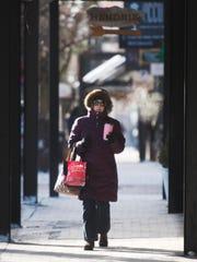 A pedestrian bundles up against sub-zero temperatures in Burlington on Thursday, December 28, 2017.