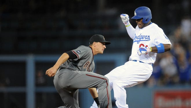 Los Angeles Dodgers right fielder Yasiel Puig (66) reaches second after hitting an RBI single in the seventh inning against Arizona Diamondbacks at Dodger Stadium.