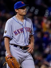 New York Mets relief pitcher Jason Vargas reacts to