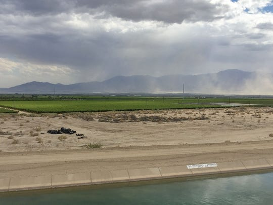 A cloud of dust moves across the landscape toward the Salton Sea (in the distance at left) on May 18, 2016. In the foreground is the Coachella branch of the All-American Canal.